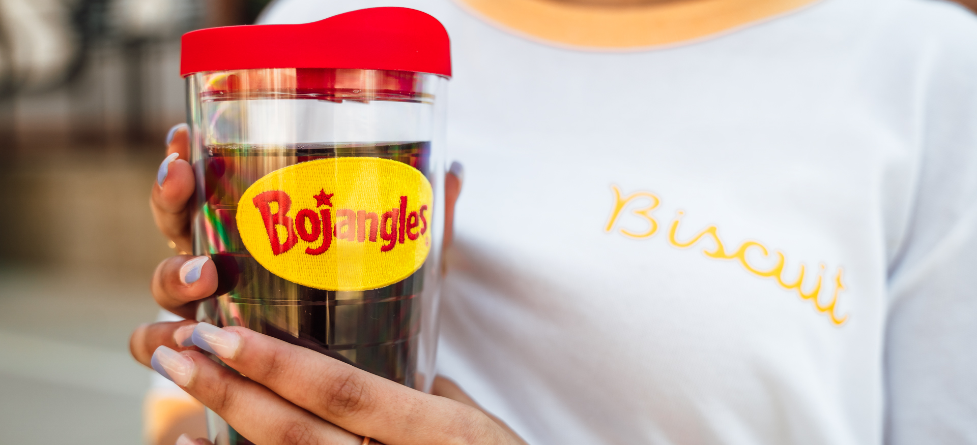 Person wearing Bojangles Biscuit tee and holding Bojangles Tervis with Bojangles Logo